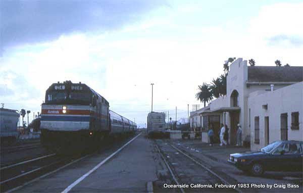 F40PH 214 with a southbound San Diegan arrives at Oceanside in February, 1983.