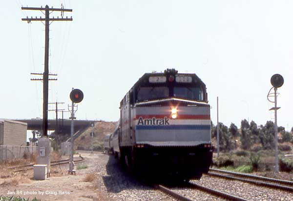 222 with a southbound San Diegan takes siding at Carlsbad, CA.