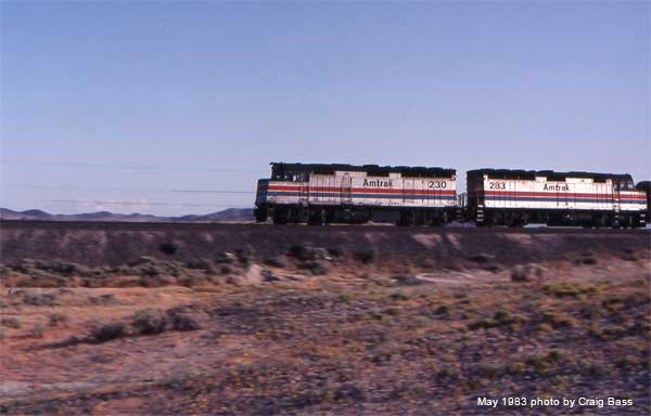 EMD F40PH's 230 and 283 hurry westbound somewhere in the desert near Yuma, Arizona in 1983 with Amtrak's Sunset Limited in May, 1983