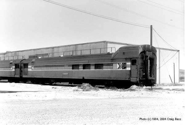 An early era Amtrak transition car sits on an industrial siding somewhere in Southern California in 1984.