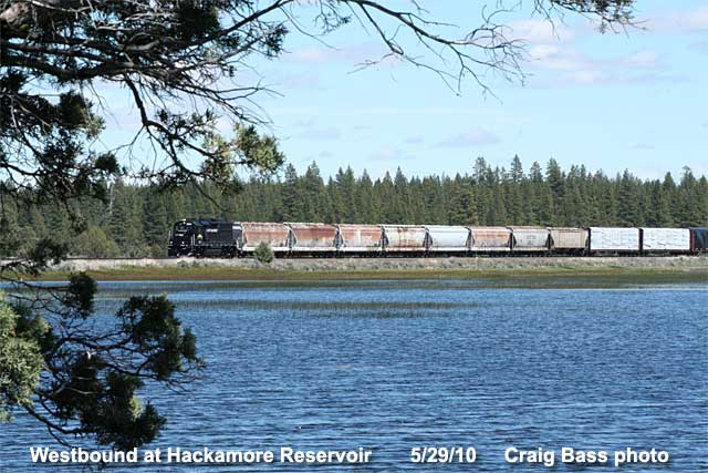Westbound LRY train passes Hackamore Reservoir