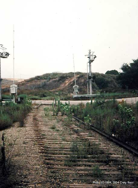 Rails have been removed at the Indian Truck Trail grade crossing, but the signals remained when I shot this photo in 1984.
